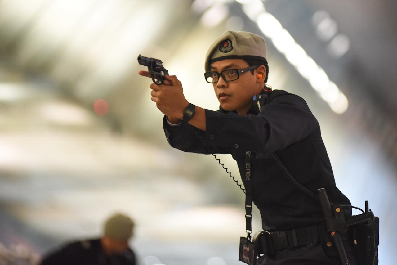 <p>Police neutralising the threats during the exercise Northstar that happened at Changi Airport Terminal 3 on 17 October, 2017. </p>