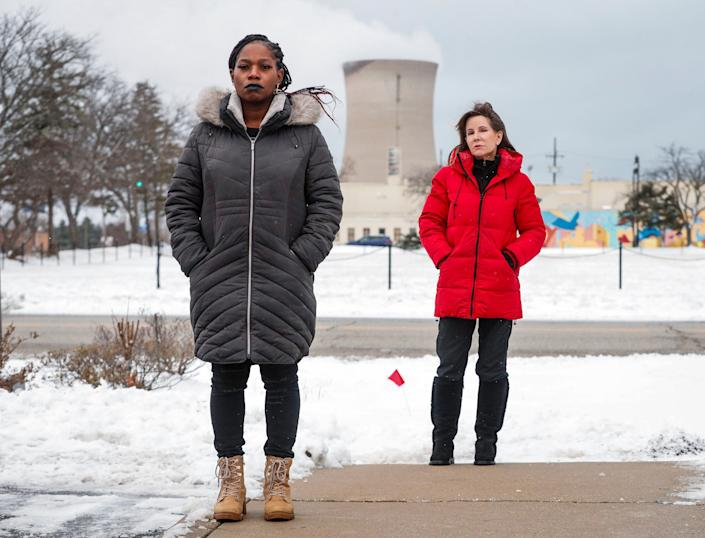 Just Transition NWI leaders La'Tonya Troutman, left, and Susan Thomas, right, pose for a photo outside of the Michigan City Planning Department on Tuesday, Jan. 27, 2021 in downtown Michigan City.