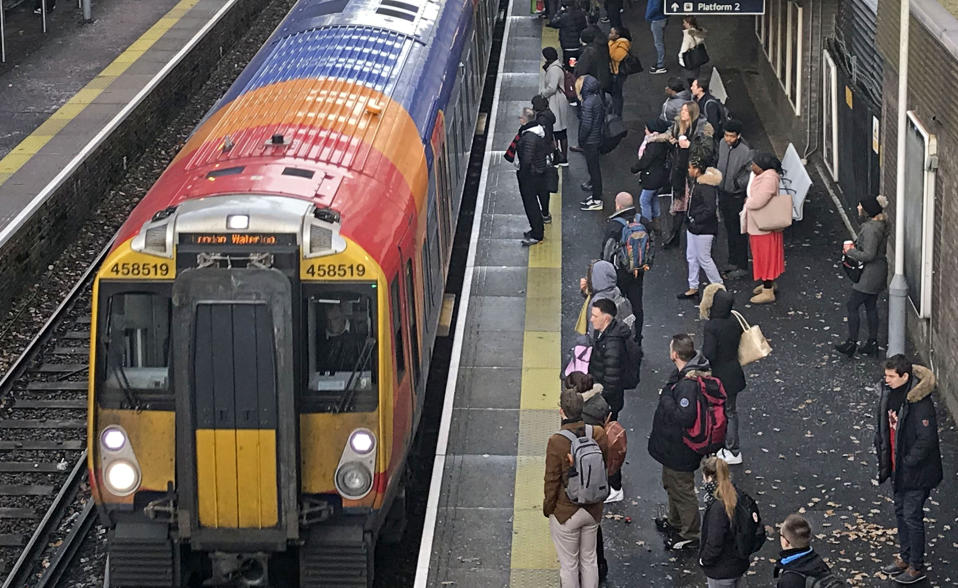 Commuters at Bracknell railway station as hundreds of thousands of rail passengers faced travel misery at the start of a series of strikes in the long-running dispute over guards on trains. (Photo by Steve Parsons/PA Images via Getty Images)