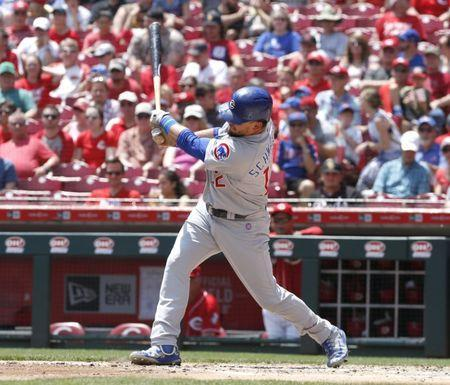 May 20, 2018; Cincinnati, OH, USA; Chicago Cubs left fielder Kyle Schwarber hits a two-run home run against the Cincinnati Reds during the second inning at Great American Ball Park. Mandatory Credit: David Kohl-USA TODAY Sports