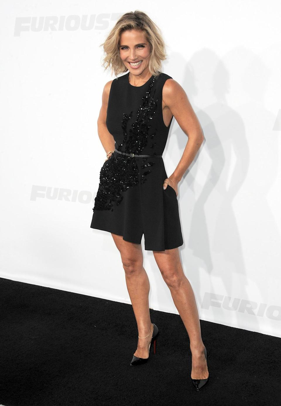 Elsa Pataky, wife of Thor (aka Chris Hemsworth) and mother of three, was fun and flirty in an Elie Saab black number. The LBD is elevated with diagonal sequin detailing and the outfit even more so with her classic patent leather Louboutins.