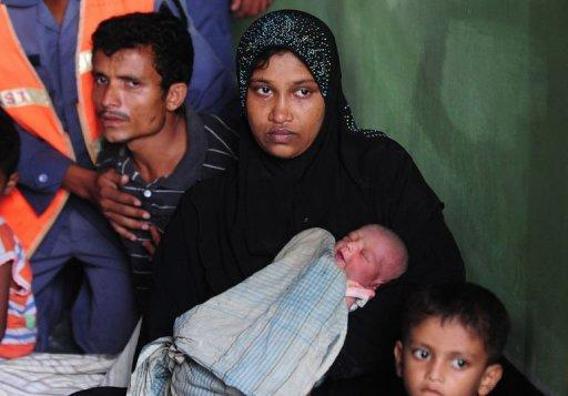 A Rohingya Muslim family from Myanmar cries after trying to escape sectarian violence