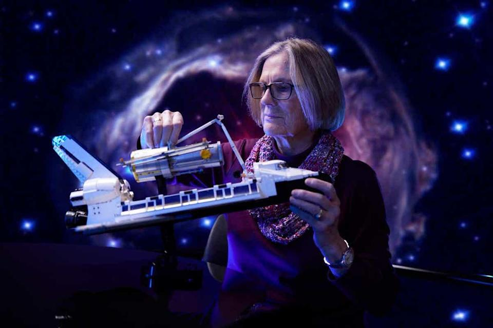 Former NASA astronaut Dr. Kathy Sullivan plays with LEGO's Discovery Space Shuttle Set