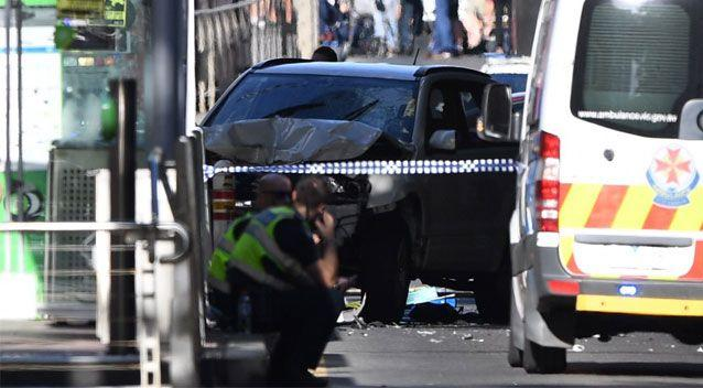 The 4WD came to a halt after colliding with a tram stop. Source: AAP