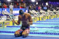 Michael Andrew reacts after winning the Men's 100 Breaststroke during wave 2 of the U.S. Olympic Swim Trials on Monday, June 14, 2021, in Omaha, Neb. (AP Photo/Jeff Roberson)