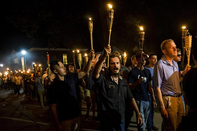 <p>Neo Nazis, Alt-Right, and White Supremacists march through the University of Virginia Campus with torches in Charlottesville, Va., on Aug. 11, 2017. (Photo: Samuel Corum/Anadolu Agency/Getty Images) </p>