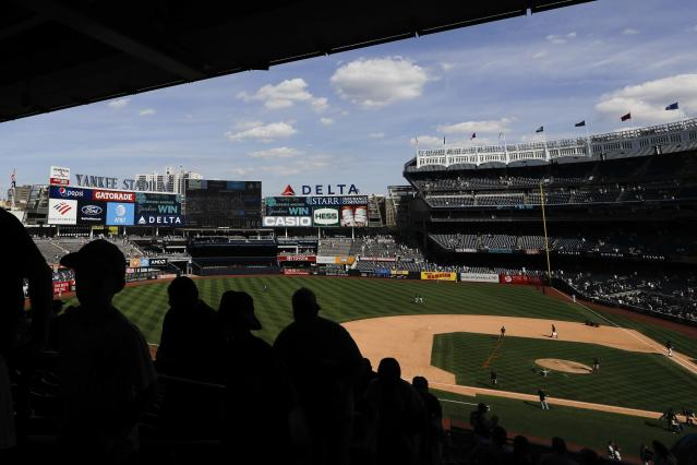 Fans leave after the first game of a baseball doubleheader between the New York Yankees and the Baltimore Orioles, Monday, Aug. 12, 2019, in New York. (AP Photo/Frank Franklin II)