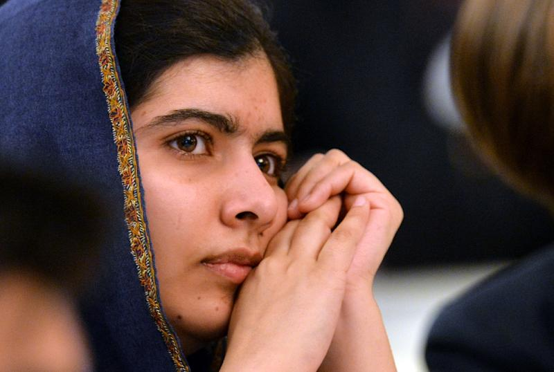 Nobel Peace Prize laureate Malala Yousafzai listens to speakers at an event in Birmingham, England on December 14, 2015, commemorating the 2014 school massacre that claimed 134 lives in Peshawar, Pakistan (AFP Photo/Paul Ellis)