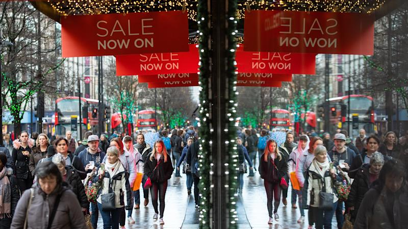 Shoppers pack into stores for final weekend before Christmas