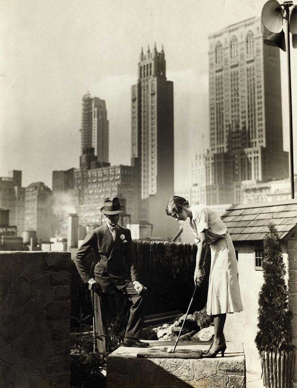 <p>Fred Astaire joins a female companion for a round of mini golf atop a New York City skyscraper in 1930. </p>