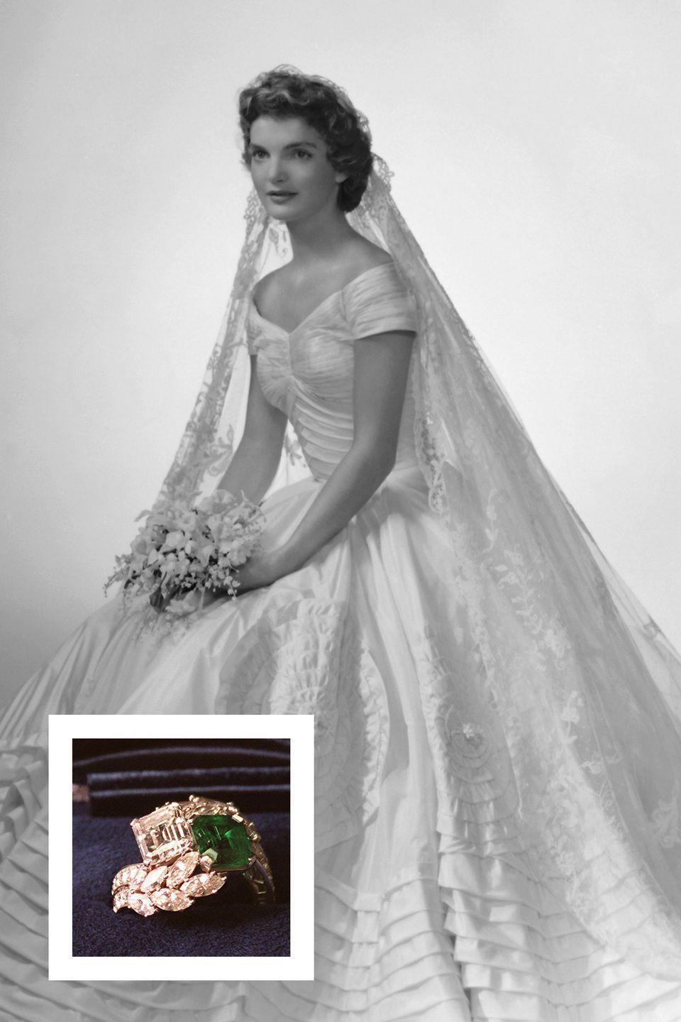 """<p>Then-Congressman <a href=""""https://www.townandcountrymag.com/society/tradition/g3320/jfk-jackie-kennedy-marriage-photos/"""" rel=""""nofollow noopener"""" target=""""_blank"""" data-ylk=""""slk:John F. Kennedy proposed to Jacqueline Bouvier"""" class=""""link rapid-noclick-resp"""">John F. Kennedy proposed to Jacqueline Bouvier</a> in 1953 with a uniquely gorgeous ring by Van Cleef & Arpels. The ring was set with a 2.88-carat diamond <a href=""""https://www.townandcountrymag.com/the-scene/weddings/news/g1616/emerald-engagement-rings/"""" rel=""""nofollow noopener"""" target=""""_blank"""" data-ylk=""""slk:and a 2.84-carat emerald"""" class=""""link rapid-noclick-resp"""">and a 2.84-carat emerald</a> with diamond accents surrounding the stones, <a href=""""https://www.vogue.com/article/jackie-kennedy-wedding-to-john-f-kennedy"""" rel=""""nofollow noopener"""" target=""""_blank"""" data-ylk=""""slk:according to Vogue."""" class=""""link rapid-noclick-resp"""">according to <em>Vogue.</em></a></p>"""