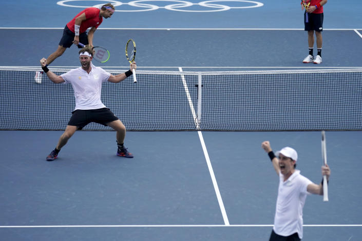 The New Zealand doubles team of Michael Venus, left, and Marcus Daniell react after defeating the team from the United States during the men's doubles bronze medal match of the tennis competition at the 2020 Summer Olympics, Friday, July 30, 2021, in Tokyo, Japan. (AP Photo/Seth Wenig)
