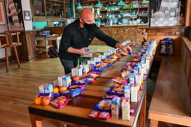 James Koch prepares free packed lunch bags for delivery at the Gallimaufry pub in Bristol