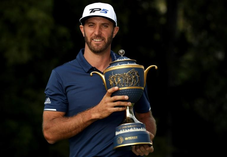 Dustin Johnson of the United States posese with his trophy after winning the World Golf Championships Mexico Championship at Club De Golf Chapultepec on March 5, 2017 in Mexico City, Mexico