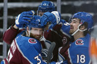 FILE - In this May, 12, 2021, file photo, Colorado Avalanche left wing J.T. Compher (37) is congratulated by teammates Valeri Nichushkin (13) and Alex Newhook (18) after scoring his third goal against the Los Angeles Kings during the second period of an NHL hockey game in Denver. Newhook went from playing in college to making an impact on his team at the most important time of the year. (AP Photo/Jack Dempsey, File)