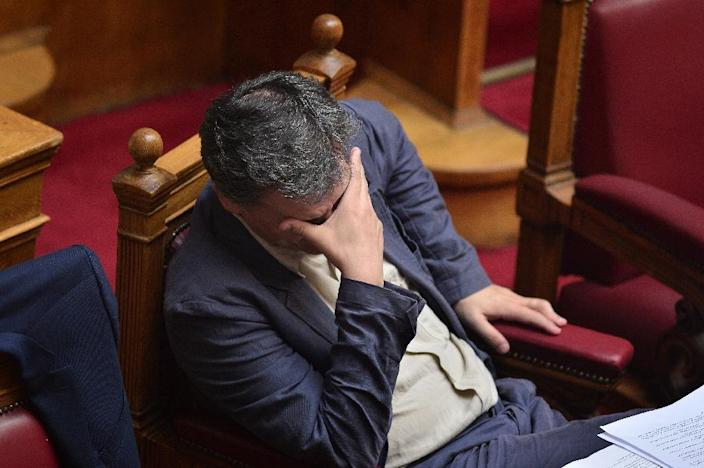 "Greek finance minister Euclid Tsakalotos told parliament ""it's a difficult deal"" (AFP Photo/Louisa Gouliamaki)"