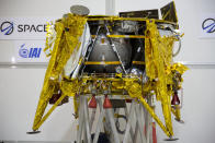 """The SpaceIL lunar module, an unmanned spacecraft, is on display in a special """"clean room"""" where the space craft is being developed, during a press tour of their facility near Tel Aviv, Israel, Monday, Dec. 17, 2018. SpaceIL and the state-owned Israel Aerospace Industries plan to launch their unmanned spacecraft to the moon early in 2019. (AP Photo/Ariel Schalit)"""