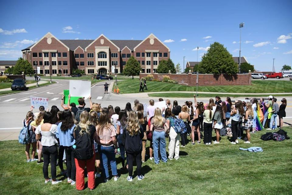 About 50 Valor Christian High School students walked out of classes to support a volleyball coach Inoke Tonga, who says he was forced to leave his job over his sexuality, in front of the high school in Highlands Ranch, Colorado on Tuesday, August 24, 2021.