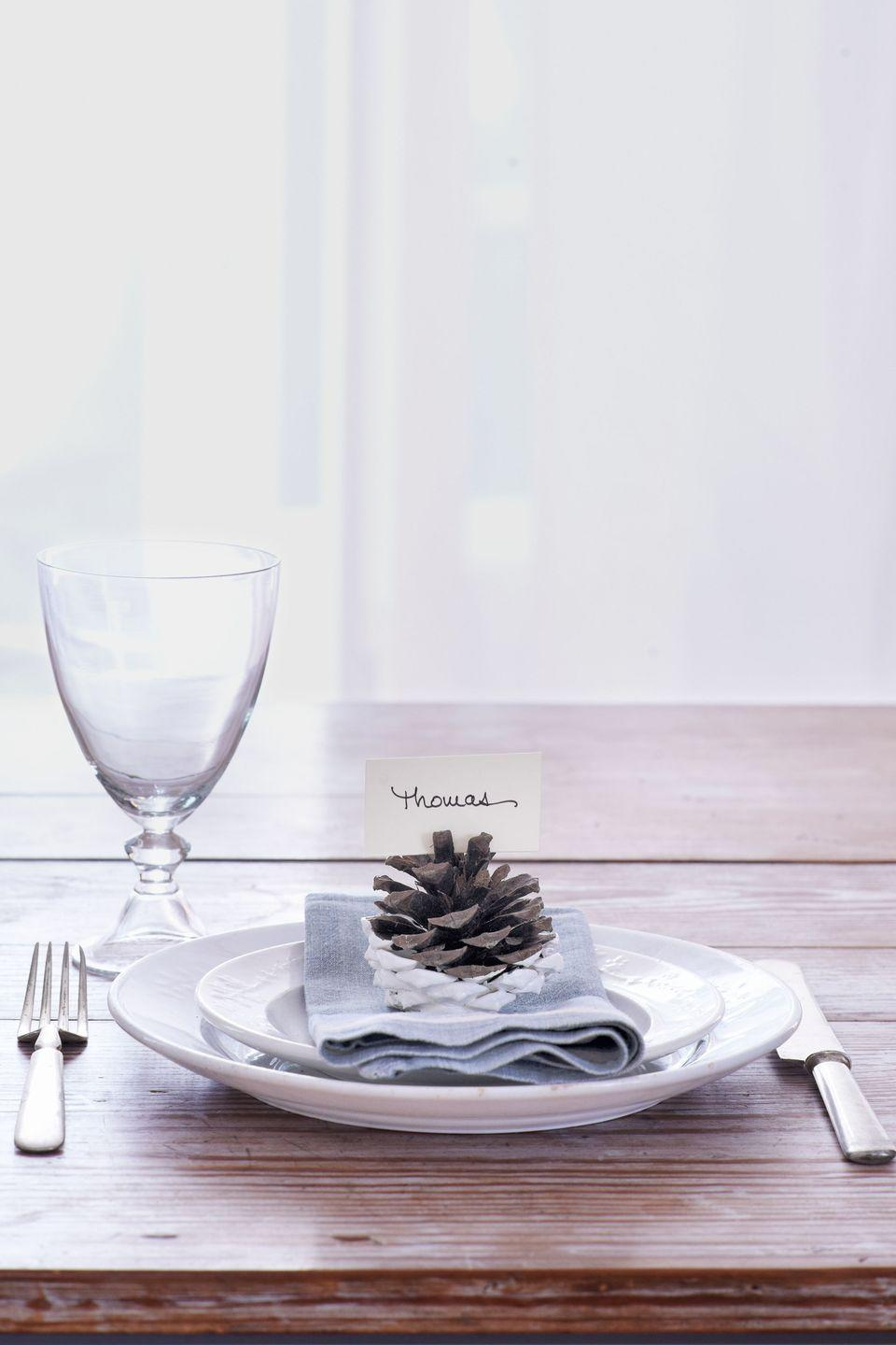 "<p>When dipped in white paint, pinecones take on a more modern appeal, explain the designers behind <a href=""http://www.foragehaberdashery.com/"" rel=""nofollow noopener"" target=""_blank"" data-ylk=""slk:Forage Haberdashery"" class=""link rapid-noclick-resp"">Forage Haberdashery</a>, Shauna Alterio and Stephen Loidolt.</p><p><a class=""link rapid-noclick-resp"" href=""https://www.amazon.com/MagiDeal-Natural-Shooting-Christmas-Decoration/dp/B07FP39XVH?tag=syn-yahoo-20&ascsubtag=%5Bartid%7C10050.g.1538%5Bsrc%7Cyahoo-us"" rel=""nofollow noopener"" target=""_blank"" data-ylk=""slk:SHOP PINECONES"">SHOP PINECONES</a></p>"