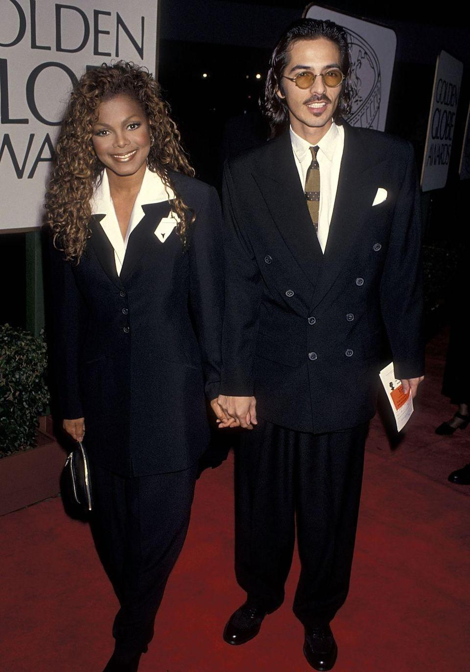 <p>The pop icon walked the carpet wearing a shiny black suit with wide lapels in 1994.</p>