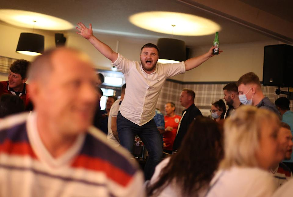 Soccer Football - Euro 2020 - Fans gather ahead of Ukraine v England - The Thistleberry pub, Newcastle-under-Lyme, Britain - July 3, 2021 England fans celebrate scoring a goal Action Images via Reuters/Carl Recine