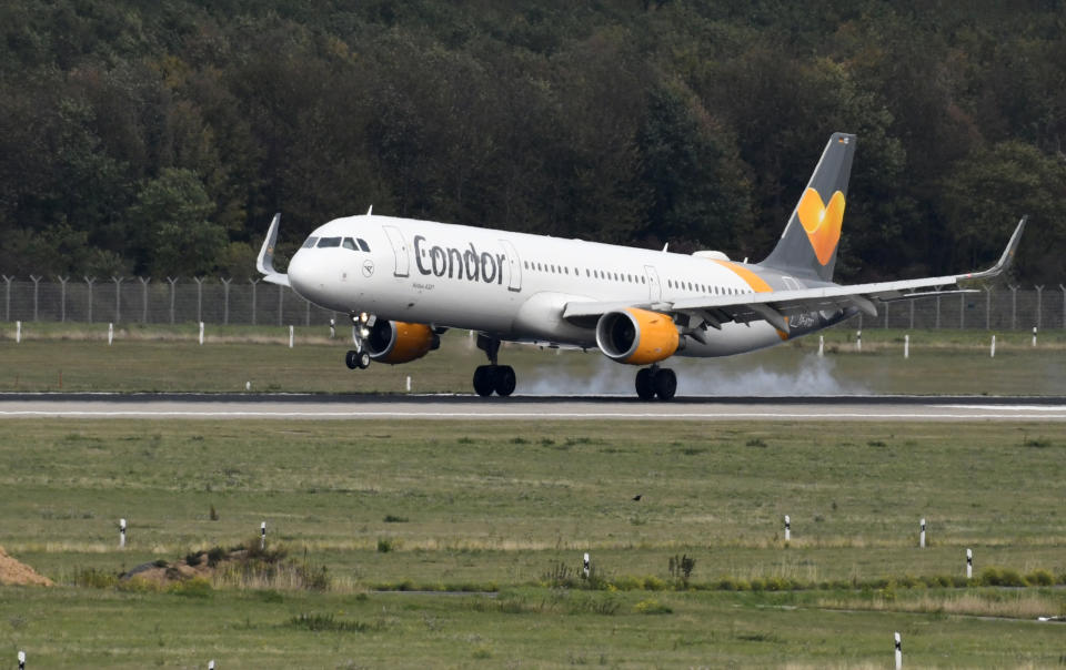"""An airplane of Condor, the German airline subsidiary of the British travel giant Thomas Cook, is seen during landing on September 24, 2019 at the airport in Duesseldorf, western Germany. - As British tour operator Thomas Cook declared bankruptcy, some 600,000 tourists from around Europe had their holidays disrupted. Thomas Cook's subsidiary Condor has said it will continue flying and applied for an emergency """"bridging loan"""" from Berlin. (Photo by Ina FASSBENDER / AFP)        (Photo credit should read INA FASSBENDER/AFP/Getty Images)"""