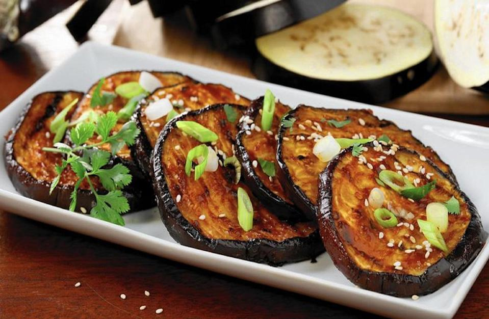 """<p>Grilled vegetarian food has a reputation for being bland and boring, but this glazed eggplant proves otherwise — it's doused in a fiery gochujang-based sauce.</p> <p><a href=""""https://www.thedailymeal.com/recipes/grilled-chili-pepper-eggplant?referrer=yahoo&category=beauty_food&include_utm=1&utm_medium=referral&utm_source=yahoo&utm_campaign=feed"""" rel=""""nofollow noopener"""" target=""""_blank"""" data-ylk=""""slk:For the Red Chili Glazed Eggplant recipe, click here."""" class=""""link rapid-noclick-resp"""">For the Red Chili Glazed Eggplant recipe, click here.</a></p>"""