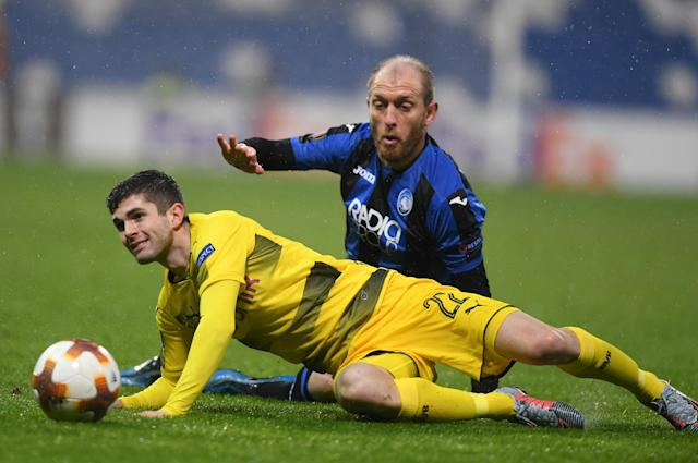Soccer Football - Europa League Round of 32 Second Leg - Atalanta vs Borussia Dortmund - Stadio Atleti Azzurri, Bergamo, Italy - February 22, 2018 Borussia Dortmund's Christian Pulisic in action with Atalanta's Andrea Masiello REUTERS/Alberto Lingria