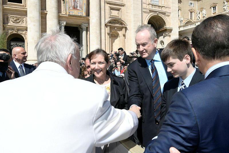The news came as Mr O'Reilly shook hands with the Pope (L'Osservatore Romano)