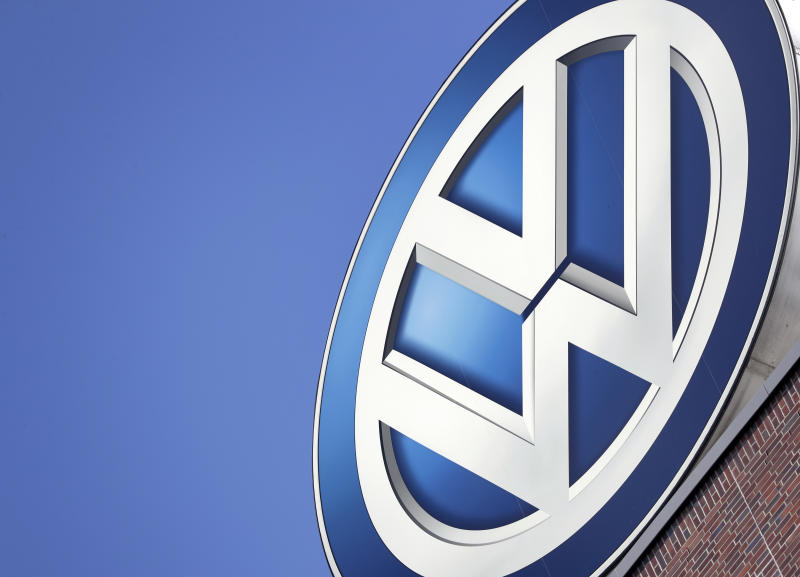 FILE - In this Wednesday, Aug. 1, 2018, file photo a logo of the car manufacturer Volkswagen is pictured on top of a company building in Wolfsburg, Germany.  Volkswagen says its profits jumped 44% in the third quarter thanks to a more profitable mix of vehicles but warned that global markets are slowing more than expected and lowered its forecast for annual sales. (AP Photo/Michael Sohn, file)