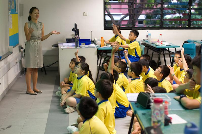 Primary 5 pupils (11 year olds) listen attentively during Math class at Singapore's Punggol Primary School on Thursday July 5, 2012. (AP Photo/Ray Chua)