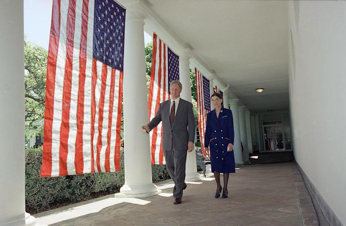 President Bill Clinton and Judge Ruth Bader Ginsburg Walt along the Colonnades of the White House in Washington on June 14, 1993, as they head to the Rose Garden for a news conference where the president nominated Ginsburg to fill the vacancy on the Supreme Court.