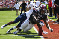 South Carolina running back Rico Dowdle scores with Charleston Southern defensive back Tavian Montgomery defending during the second quarter of an NCAA college football game Saturday, Sept. 7, 2019, in Columbia, S.C. (AP Photo/John Amis)