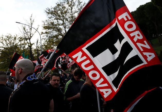 A supporter of Italy's far-right Forza Nuova party holds a flag during a demonstration in Rome, Italy November 4, 2017. REUTERS/Stefano Rellandini (Photo: Stefano Rellandini via Reuters)