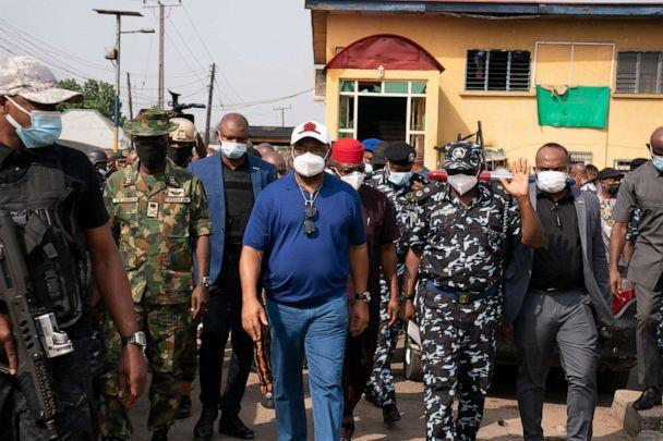 PHOTO: Imo state Gov. Hope Uzodinma, center, inspects the scene of an attack at the police command headquarters in Owerri, Nigeria, April 5, 2021, after inmates escaped from a prison in the southeastern Nigerian city after a series of coordinated attacks. (David Dosunmu/AP)
