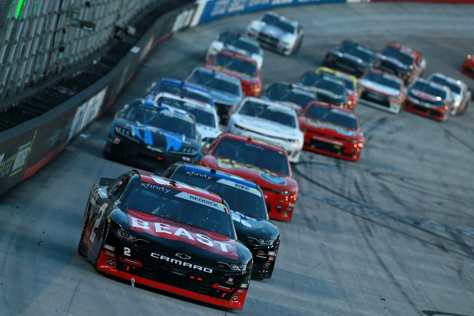 BRISTOL, TENNESSEE - AUGUST 16: Tyler Reddick, driver of the #2 Tame the BEAST Chevrolet, leads a pack of cars during the NASCAR Xfinity Series Food City 300 at Bristol Motor Speedway on August 16, 2019 in Bristol, Tennessee. (Photo by Sean Gardner/Getty Images)