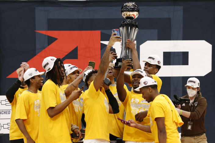 St. Bonaventure players raise the trophy after beating VCU in an NCAA college basketball championship game for the Atlantic Ten Conference tournament Sunday, March 14, 2021, in Dayton, Ohio. St. (AP Photo/Jay LaPrete)