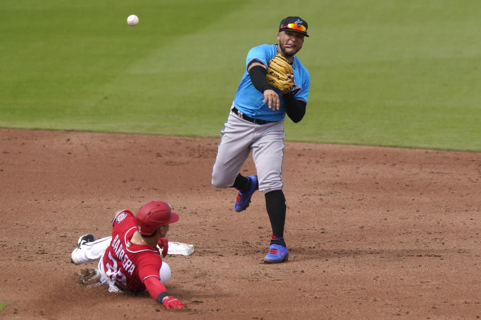 Washington Nationals' Tres Barrera (38) is out at second as Miami Marlins second baseman Isan Diaz throws to first for a double play during the third inning of a spring training baseball game, Wednesday, March 3, 2021, in West Palm Beach, Fla. Diaz is competing with fellow prospect Jazz Chisholm for the second base job. (AP Photo/Lynne Sladky)