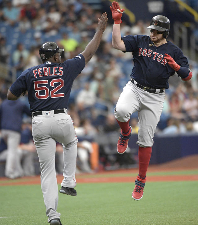 Boston Red Sox catcher Christian Vazquez, right, celebrates with third base coach Carlos Febles (52) while rounding the base after hitting a three-run home run during the first inning of a baseball game against the Tampa Bay Rays Sunday, Sept. 22, 2019, in St. Petersburg, Fla. (AP Photo/Phelan M. Ebenhack)