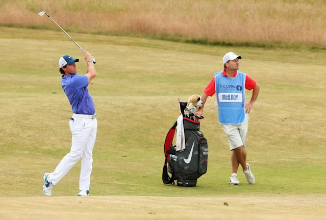 GULLANE, SCOTLAND - JULY 17: Rory McIlroy of Northern Ireland hits a shot as caddie JP Fitzgerald ahead of the 142nd Open Championship at Muirfield on July 17, 2013 in Gullane, Scotland. (Photo by Andrew Redington/Getty Images)