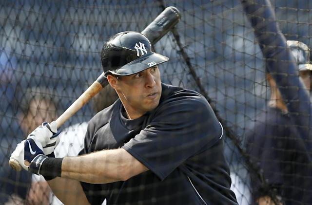 New York Yankees' Mark Teixeira, who has suffered from recurring wrist problems since suffering a wrist injury and undergoing season-ending surgery last year, keeps his eyes on the ball while taking batting practice before the Yankees' baseball game against the Oakland Athletics at Yankee Stadium in New York, Tuesday, June 3, 2014. (AP Photo/Kathy Willens)
