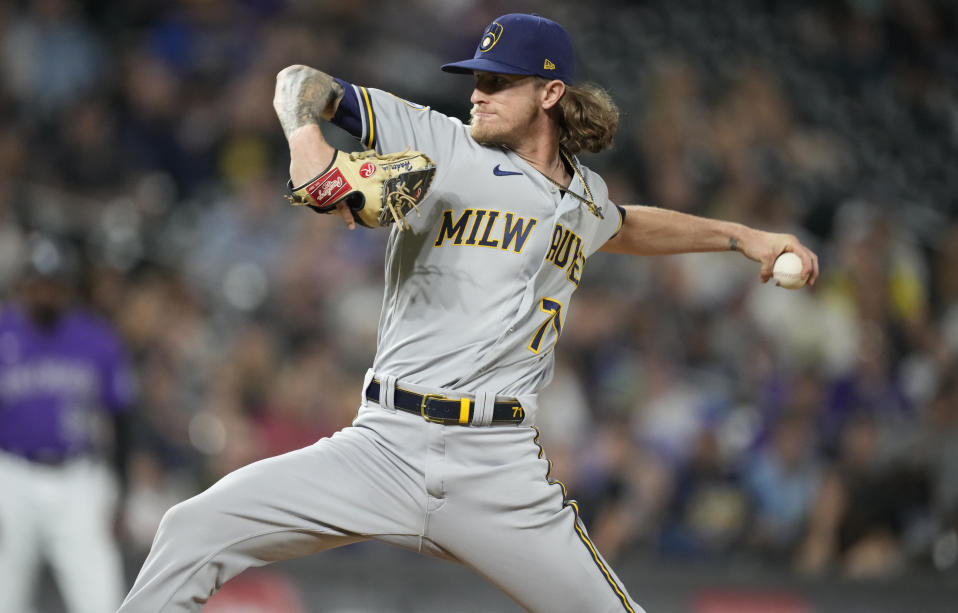 Milwaukee Brewers relief pitcher Josh Hader works against the Colorado Rockies during the ninth inning of a baseball game Saturday, June 19, 2021, in Denver. Milwaukee won 6-5. (AP Photo/David Zalubowski)