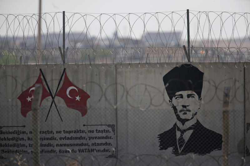 A graffiti of modern Turkey's founder Mustafa Kemal Ataturk is seen on the Turkish side of the border between Turkey and Syria, in Akcakale, Sanliurfa province, southeastern Turkey, Tuesday, Oct. 8, 2019.  Turkey's vice president Fuat Oktay says his country won't bow to threats in an apparent response to U.S. President Donald Trump's warning to Ankara about the scope of its planned military incursion into Syria.(AP Photo/Lefteris Pitarakis)