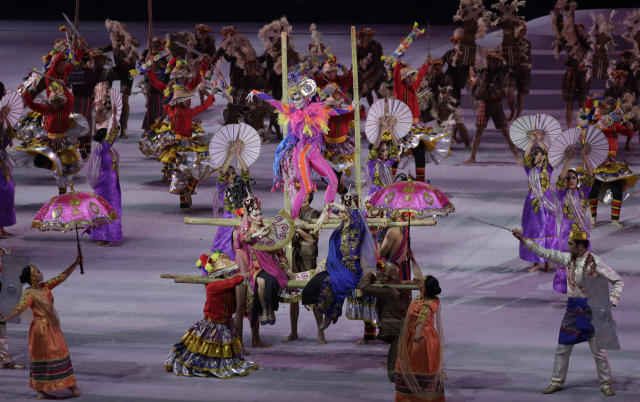 Dancers perform opening ceremonies of the 30th South East Asian Games at the Philippine Arena, Bulacan province, northern Philippines on Saturday, Nov. 30, 2019. (AP Photo/Aaron Favila)