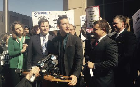 Anti-abortion activist David Daleiden speaks at a news conference outside a court in Houston Texas