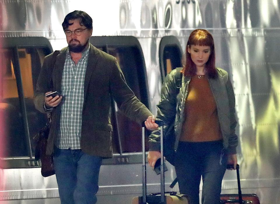 "BOSTON, MA - DECEMBER 1: Actors Leonardo DiCaprio and Jennifer Lawrence walk along the train platform next to an Acela train at South Station during on location filming of ""Don't Look Up"" at South Station in Boston on Dec. 1, 2020. The film stars Jennifer Lawrence, Leonardo DiCaprio, Meryl Streep, and is directed by Adam McKay. (Photo by David L. Ryan/The Boston Globe via Getty Images)"