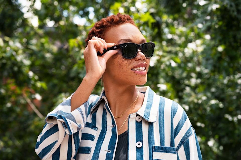 Stylish woman wearing Facebook's Ray-Ban Stories smart glasses