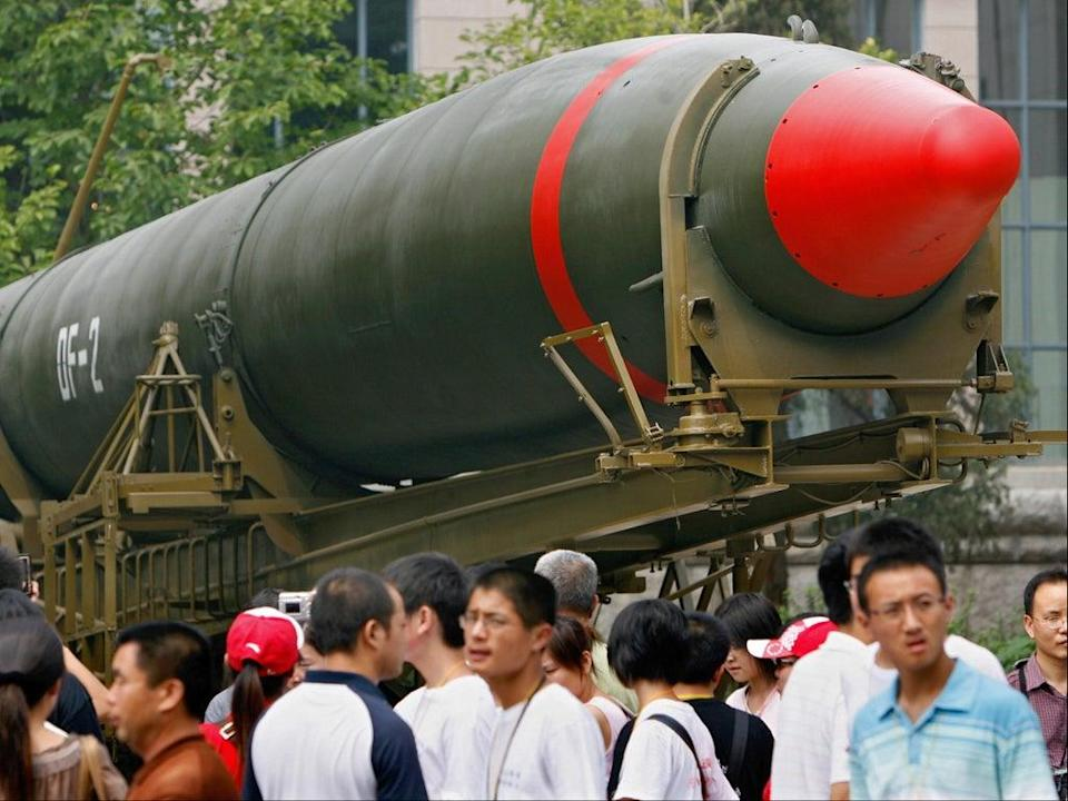 Visitors in Beijing walk past China's second ever nuclear missile on display at a museum (AFP via Getty Images)