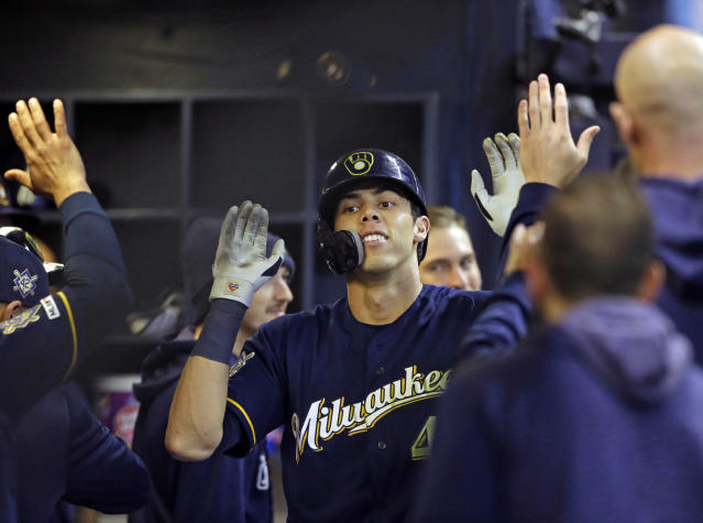 Milwaukee Brewers' Christian Yelich reacts after his home run against the St. Louis Cardinals during the eighth inning of a baseball game Monday, April 15, 2019 in Milwaukee. It was Yelich's third home run of the game. (AP Photo/Jeffrey Phelps)