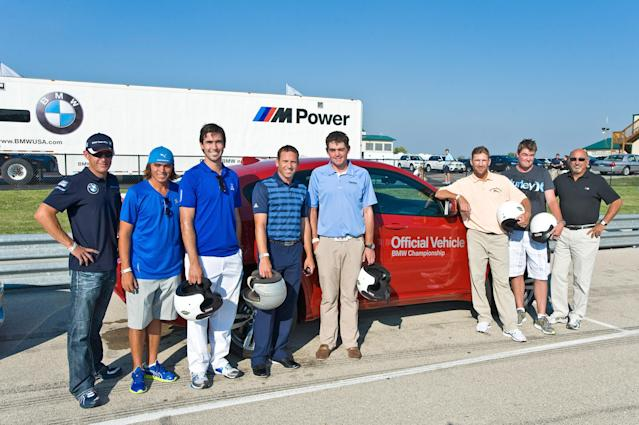 CHICAGO, IL - SEPTEMBER 13: (L to R) BMW American Le Mans Series race driver Joey Hand and PGA TOUR players Rickie Fowler, Cameron Tringale, Sergio Garcia, Keegan Bradley, George McNeil, Mark Leishman, and legendary race car diver Bobby Rahal help kick- off the BMW Championship by driving at a race track for charity at Autobahn Racetrack on September 13, 2011 in Joliet, Illinois. (Photo by Timothy Hiatt/Getty Images for BMW)